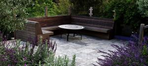 bespoke-hardwood-seating-with-travertine-paving