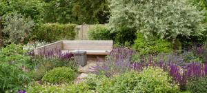 built-in-hardwood-seating-surrounded-with-planting-mike-harvey-gardens