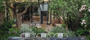 garden-table-and-mature-olive-trees-richmond